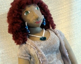 Cloth sculpture of knitter, 17 inch cloth doll, named Fiona, carrying bag of yarn and knitting needles