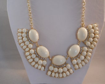 Bib Necklace with Cream Color Beads, Rhinestones and Gold Tone Pendants on a Gold Tone Chain