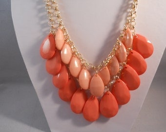 2 Row Bib Necklace made with 2 Shades of Peach Teardrop Pendant Beads on a Gold Tone Chain