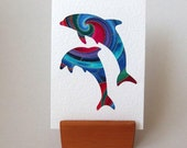 """DOLPHINS Fabric Greeting Card -  6"""" x 4"""" with envelope. Blank Note Card. Porpoises on rainbow fabric with gold accents. White Textured Card."""