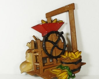 Metal Homco Wall Plaque – Corn Grinder