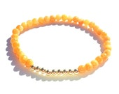 Elastic stretchy bracelet with Orange Calcite and Gold fill beads. Gemstone Bracelet. Galentines Day Gift Bracelet. Stretchy bracelet.