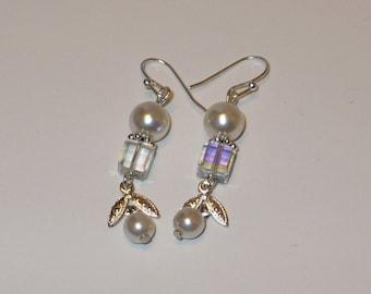 White pearl and crystal dangle earrings.