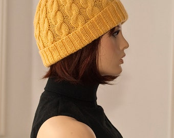 Knitted cabled hat with pompom, yellow color, for women, woolen.