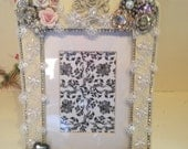 Jeweled Frame Embellished With White lace With Pearls Attached, Porcelain Roses, Rhinestone Broaches, Framed in Rhinestones,