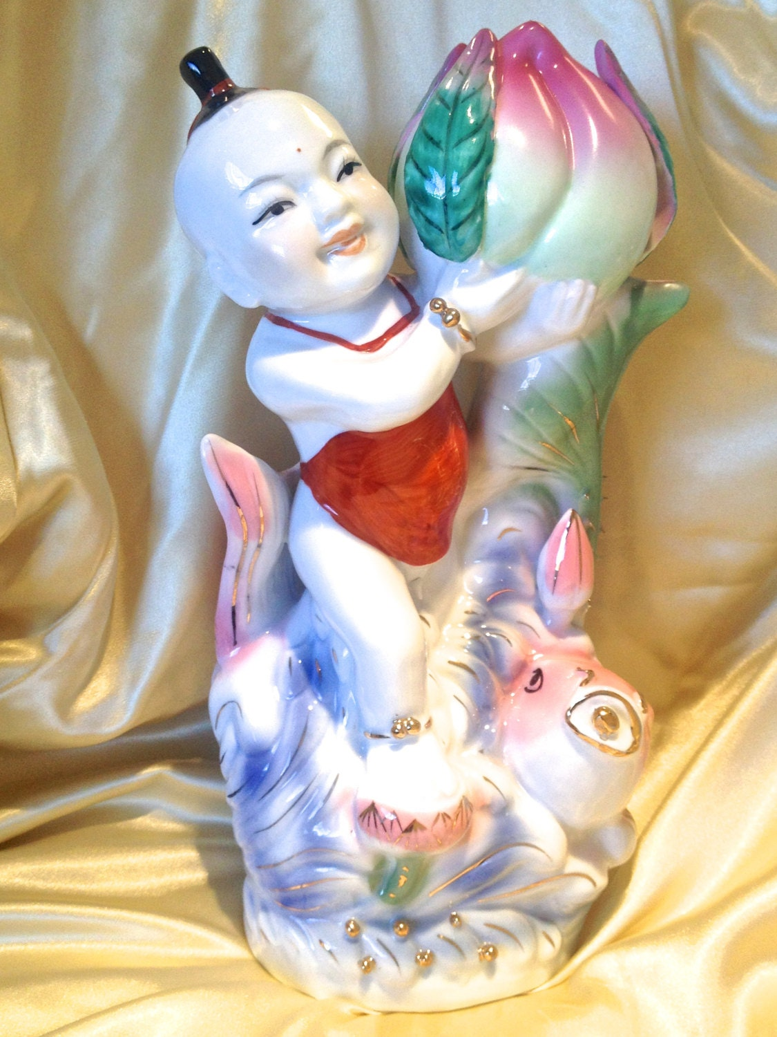 Porcelain chinese longevity child riding a koi fish vintage for Koi fish figurines
