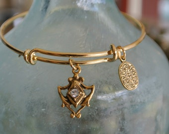 Gold Adjustable Bangle Bracelet // medallion crest charm // oval textured charm // medallion crest bracelet