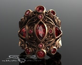 Marsala 18kt garnet ring in rose red gold with black gold accents. 5.3 cttw rhodolite & ornate scrollwork wide ring cigar band cocktail.
