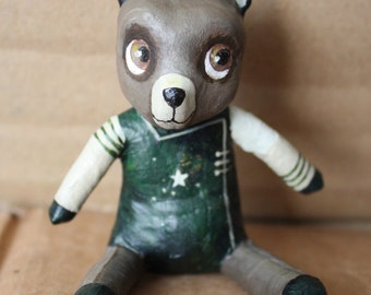 Clear brown bear with his green tunic to the star
