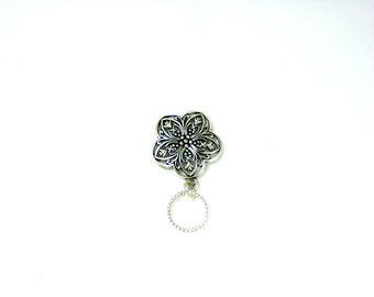 Silver Tone Flower Style Charm Made Into a Unique and Stylish Pin Eyeglass Holder.  Pin Back Makes It Easy to Transfer to Different Clothes.