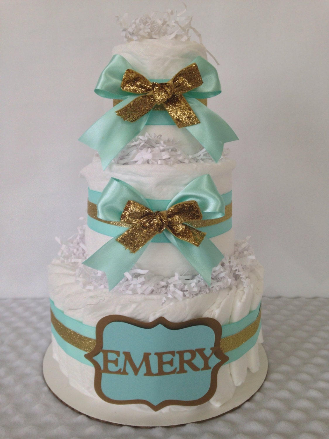 Mint and gold baby diaper cake centerpiece mint and gold baby for Baby shower decoration diaper cake