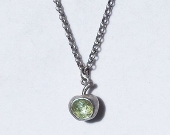 "Sterling Silver apple filled with ""It's a Mad, Mad, Mad, Mad World"" car glass necklace"