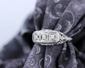 14K White Gold Ring with a Diamond Trio