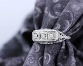 14K White Gold Ring with a Diamond Trio