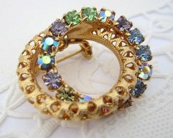 Rhinestone Double Ring Eternity Brooch Gold Tone with Purple Green & Blue AB Rhinestones Vintage 1970's Pin