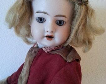 Antique doll. Bisque doll.  Doll with original dress. Fleischmann . SFBJ doll. Collecting doll.