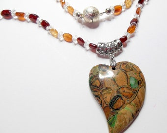 Rainforest Rhyolite is the Perfect Piece to Carry When Facing Confrontation.