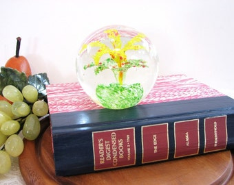 Blown Art Glass Paperweight ... Crystal Clear with Yellow Flower and Green Leaves ... Round. Sphere. Orb