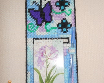 Purple Butterfly & Blue Flowers Notebook Holder in plastic canvas wall hanging