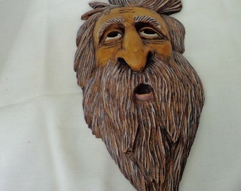 This is a Wood Spirit that hangs on the wall and is reputed to bring good luck.
