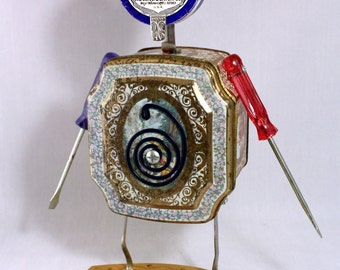 """Whimsical, metal, found object assemblage made from second hand, re-purposed materials. Unique, robot folk art.  """"M.W. Dunton"""""""