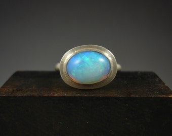 Solid opal silver ring