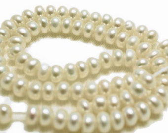 White button pearls.   Approx. 6-6.5mm.  (20 pearls)