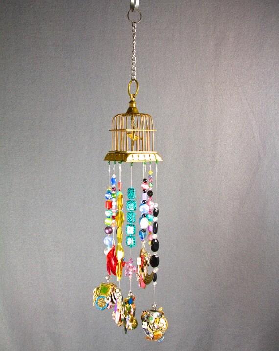 Outdoor chandelier outdoor hanging art outdoor sun for Hanging ornaments from chandelier