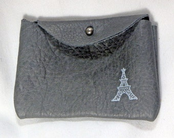 small grey leather pouch with Eiffel tower print