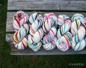 White Here n There handspun rainbow yarn self striping merino wool yarn 120 yds