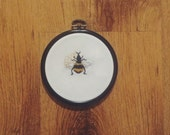 Miniature bumble bee embroidery hanging