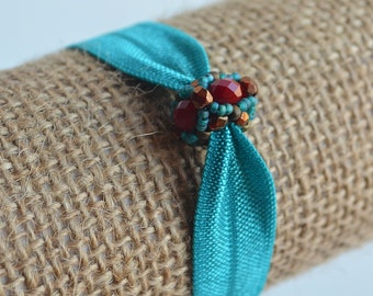 Turquoise and Red Beaded Bead On Stretchy Turquoise Elastic Band Bracelet