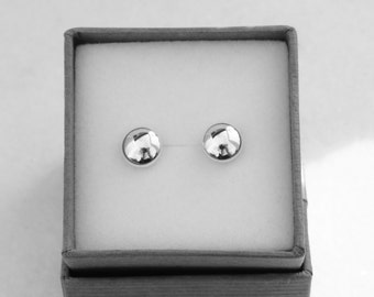 Sterling silver shiny 8mm cushion studs.