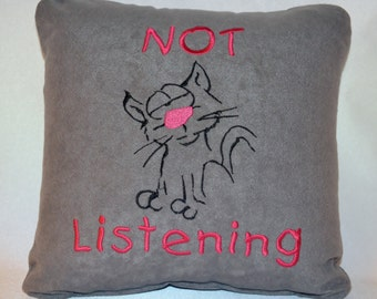 """10 x 10 pillow with embroidered cat """"Not Listening"""""""