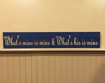 "Carved ""What's mine is mine & What's his is mine"" sign"