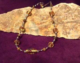 Topaz and Tiger Eye necklace; Topaz foil-lined glass bead and Tiger Eye necklace; Lampwork glass and Tiger Eye necklace; Beaded Necklace