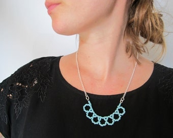 Necklace with light blue beads and silver chain