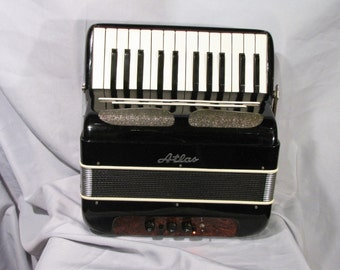 Small battery amplifier mp3 player built out of an old 1950s accordion