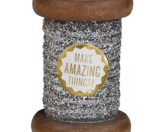 Silver Sparkle Ribbon on Wooden Spool