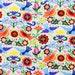 Laminated cotton fabric aka oilcloth Alexander Henry La Paloma Multi Brights