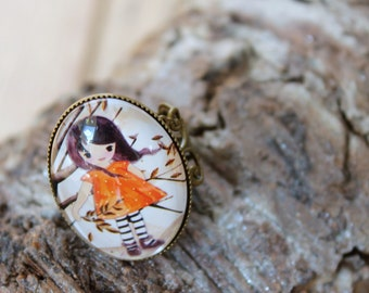 filigree bronze ring with a cute girl motif