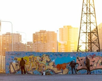 Helsinki graffiti   Joe Jukes photography   A photograph of artists painting in the street in an industrial area of the city centre.
