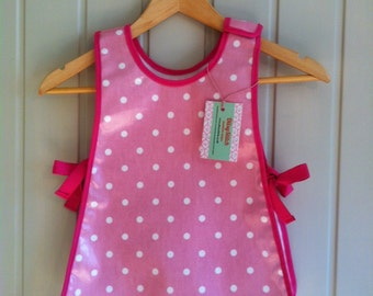 Wipe clean apron tabard style for messy play, painting and baking.