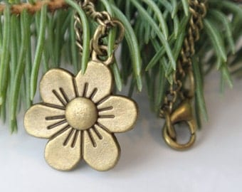 Flower of life on antique brass chain. Pendant Bronze. The choice and choice of chain length.