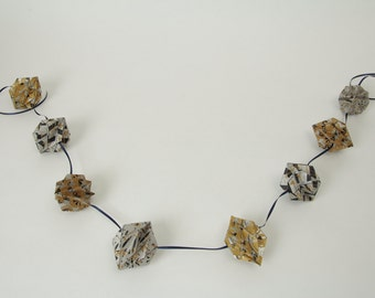 Three dimensional paper diamond garland.
