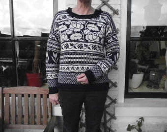 Knitted dark blue Jersey with white tulips pattern.