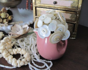 tiny vintage pitcher with mother of pearl button flowers
