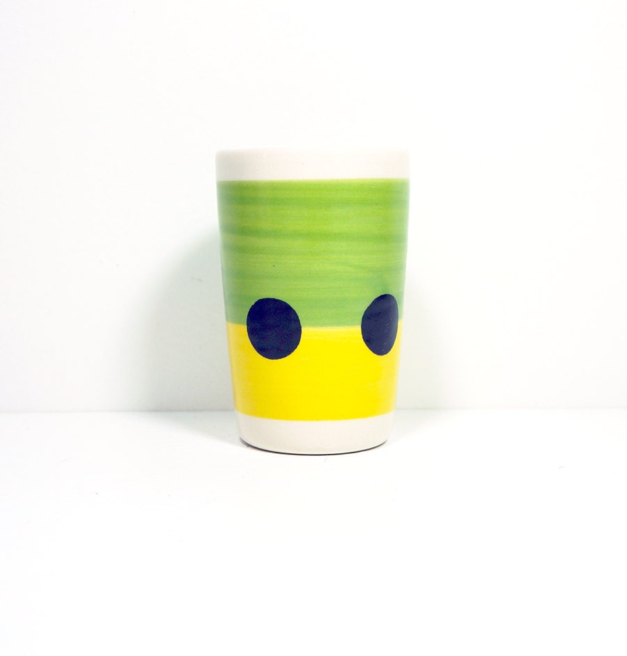 itty bitty cylinder in colour block of leaf green and yellow with a black polkadot belt, made to order.