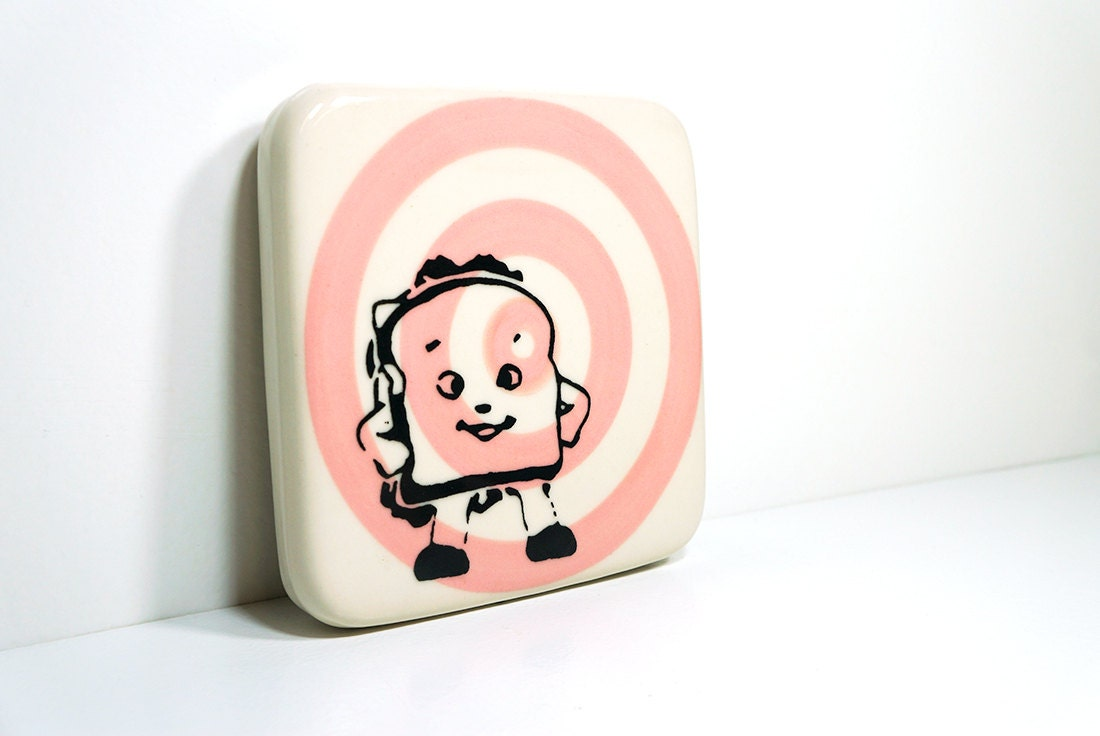 tile with a happy sandwich striking a hero pose on a pink bullseye, made to order / pick your colour
