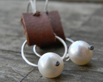 silver rings on brown leather with creamy freshwater pearls -dangle earrings